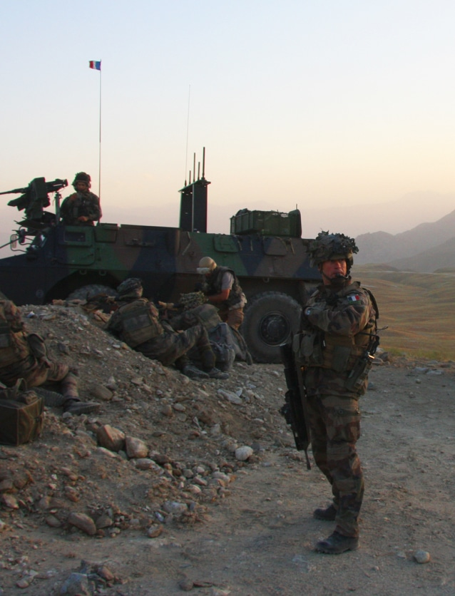 Photographie de militaires sur le terrain illustrant la marque Sofexi.